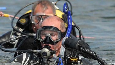Not what it seemed to be ... Russian Prime Minister Vladimir Putin dives for treasure.