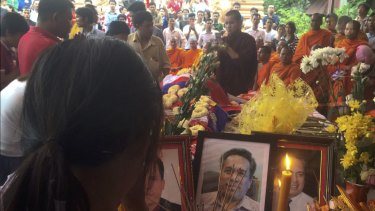 A mourner at the Buddhist funeral rites for commentator Kem Ley.