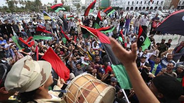 Gaddafi dead ... Libyans celebrate at Martyrs Square in Tripoli.