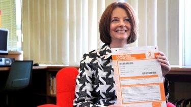 Prime Minister Julia Gillard holding a NAPLAN test.