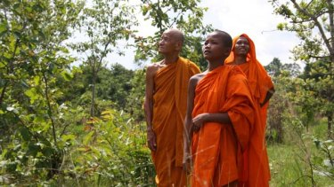 Reclaiming the land ... monks in their forest. They want to earn money from rich countries by conserving the forest to sequester carbon.