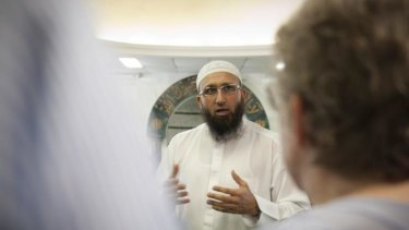 Imaan Uzii Akbar speaking to visitors to the Holland Park mosque on September 19.