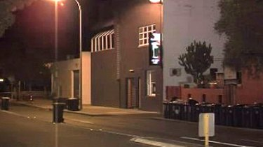 Police tape ropes off the street outside the Irish Club in Perth's Subiaco, where the attack occurred.
