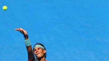 Rafael Nadal serves against Grigor Dimitrov.