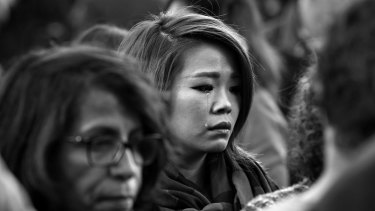 Faces of Paris. Parisians silently paid respect to the 129 people killed in the terror attack in Paris across many memorial sites including Le Carillon bar on Sunday 15 November.