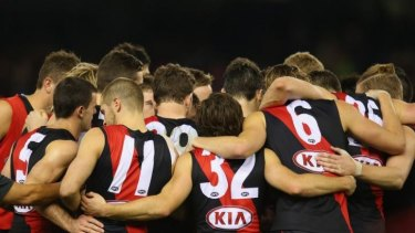 The Essendon Bombers form a huddle during the round 14 AFL match with the Adelaide Crows in July.