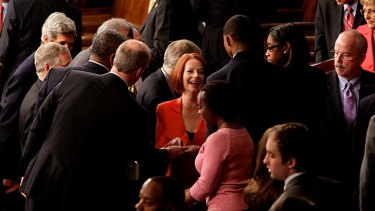 Australia Prime Minister Julia Gillard signs autographs after she addressed a Joint Meeting of Congress in Washington DC.
