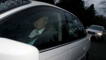 Off to be sworn in: Prime Minister designate Kevin Rudd leaves his Canberra hotel on Thursday morning.