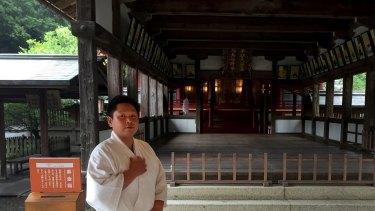Yoshihiro Suzuki, a 32 year-old Shinto priest, poses at the Munakata Taisha shrine in Okinoshima, Japan.