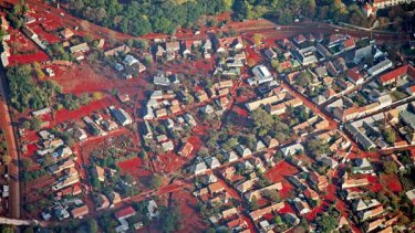 Red death ... caustic red sludge from the chemical spill engulfs the Hungarian village of Devecser.