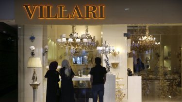 Iranians window shopping at the Palladium shopping centre in northern Tehran on Saturday even though it will probably be months before sanctions ease.