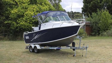 Purchased by overdrawing a St George Bank account ... a motor boat.
