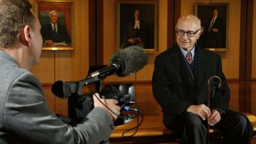 Documentary maker Kris Kerehona filming architect Romaldo Giurgola, 92, in the Members Hall of Parliament House, which he designed, on Monday.