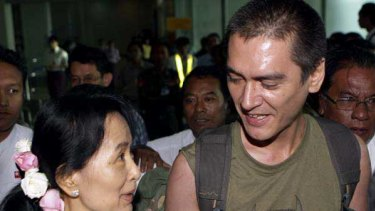 Aung San Suu Kyi meets son Kim Aris at Rangoon Airport.