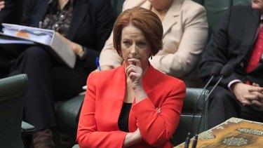 Prime Minister Julia Gillard listens to the debate over asylum seekers.