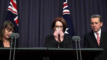 Prime Minister Julia Gillard, centre, with outgoing Attorney-General Nicola Roxon and Senator Chris Evans.
