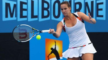 Jarmila Gajdosova plays a forehand in her first round match against Jelena Dokic.