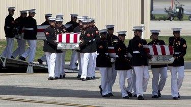Slain US officials' caskets.