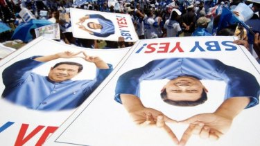 Supporters hold banners of Indonesian President Susilo Bambang Yudhoyono at an election campaign in 2009.