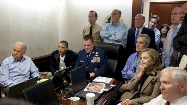 President Barack Obama and Vice President Joe Biden, along with members of the national security team, receive an update on the mission against Osama bin Laden in the Situation Room of the White House, in May 2011.