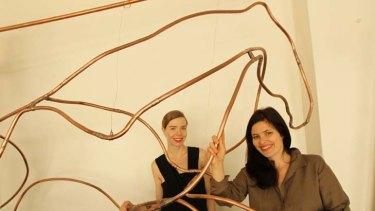 Partners ... designer Bianca Spender, left, and artist Anna-Wili Highfield with Highfield's horse sculpture.