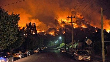 An image of a bushfire uploaded to the Facebook page of a man accused of threatening State Government employees.