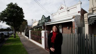 Darlene Reilly of the Sunshine Residents and Ratepayers Association, at terrace houses on Benjamin Street, Sunshine.