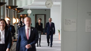 Prime Minister Malcolm Turnbull and Minister for Jobs Michaelia Cash walk behind Opposition Leader Bill Shorten.