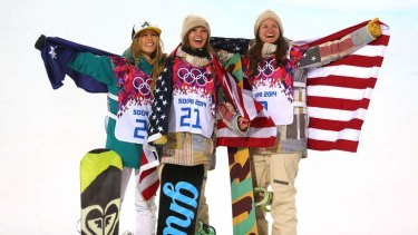 Silver medalist Torah Bright of Australia, gold medalist Kaitlyn Farrington of the United States and bronze medalist Kelly Clark of the United States celebrate during the flower ceremony for the Snowboard Women's Halfpipe Finals on day five of the Sochi 2014 Winter Olympics.