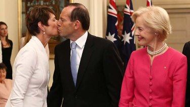 Tony Abbott kisses his wife Margie after being sworn in as Australia's 28th Prime Minister by Governor-General Quentin Bryce, right, today.