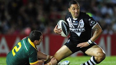 Marked man ...  Benji Marshall fails to get past Darius Boyd in last night's Test match between the Kangaroos and the Kiwis in Townsville. The win was a much-needed boost for coach Tim Sheens.