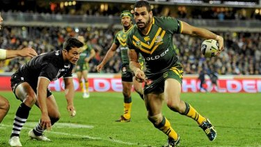 Up and running: Greg Inglis during Friday's game.
