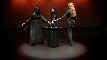 High School students from left, Martha De Ramos, Shoshana Lewis and Emily Bell playing the witches as they run through a scene in a production of <i>Macbeth</i> as part of the Bell Shakespeare Schools Festival during a rehearsal Calwell School Theatre.