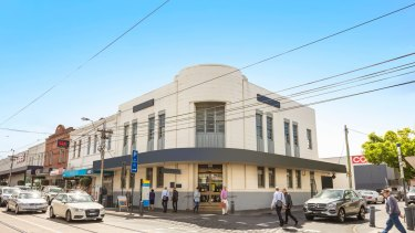 A Malvern landmark - the  corner building at 146 Glenferrie Road - sold under the hammer for $6.392 million.