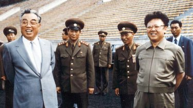 Kim Il-sung, left, and son Kim Jong-il inspect a Pyongyang stadium in 1992.