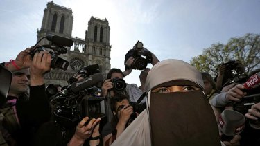 Defend ... Kenza Drider, a French Muslim of North African descent, wears a niqab outside the Notre Dame on the first day of the ban.