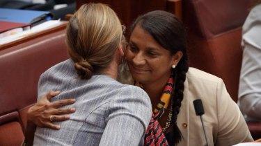 Senator Nova Peris is embraced by Senator Kate Lundy.