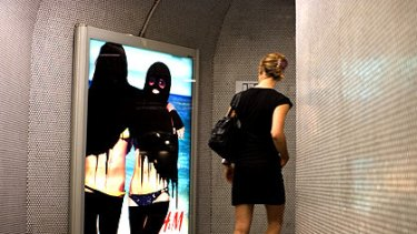 Hijabisation: Graffiti artist Princess Hijab targets high fashion advertising in the Paris metro.