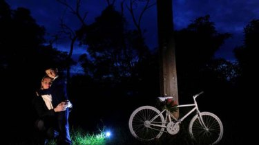 Jo and her son Ryan at the ghost bike site on Mount Eliza Road for Russell Myers, and a ghost bike is made ready.