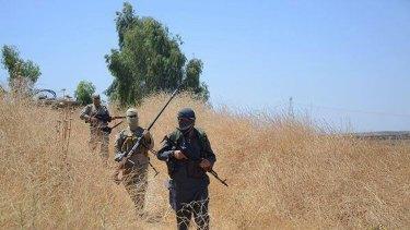 An Islamic State patrol in Khazer, Iraq.