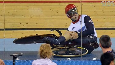 Real downer ... Philip Hindes after falling down during the men's team sprint qualifying round.