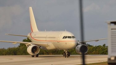 The first plane load of asylum seekers takes off for Nauru.