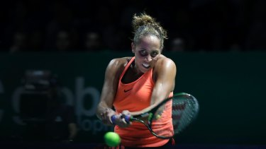 Madison Keys returns against Simona Halep.