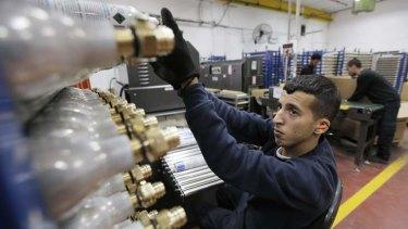 A Palestinian worker in a SodaStream factory in the West Bank.