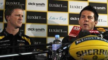 Richmond's Ben Cousins announces his retirement, flanked by coach Damien Hardwick.