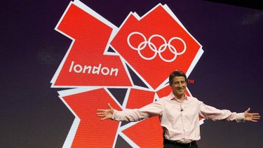 London 2012 chairman Sebastian Coe stands in front of the London 2012 Olympic logo.