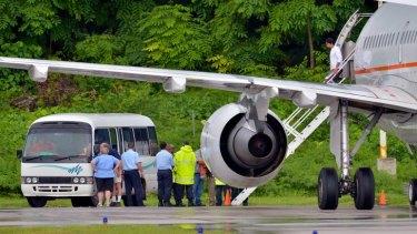 A planeload of asylum seekers arrives on the island.