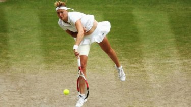 Petra Kvitova serves to Eugnie Bouchard during Saturday's women's final.