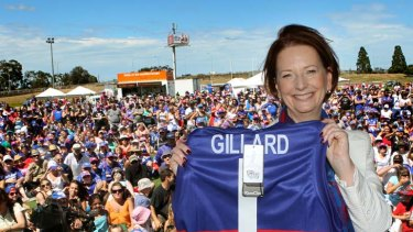 Joint No. 1 ticket holder Julia Gillard shows off the Western Bulldogs jumper she received at Whitten Oval, where she attended the club's family day yesterday.