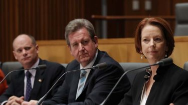 Question time ... the Queensland and NSW premiers, Campbell Newman and Barry O'Farrell, and the Prime Minister, Julia Gillard, at a post-COAG news conference.